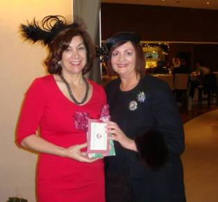 Barbara Bisel and Elena Daciuk tied for Best Ornament. Barbara's was a red leopard print purse and Elena's was a mirror with rhinestones.